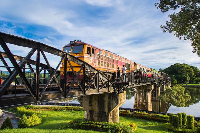 A train cross River Kwai Bridge | train trips from Bangkok | Bangkok Food Tours