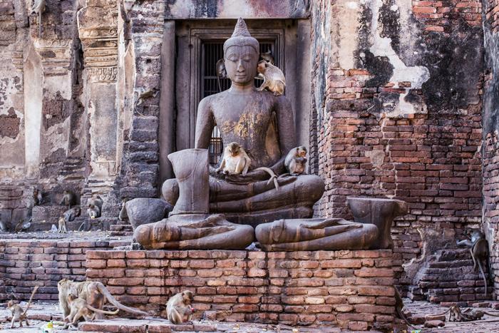 Buddha statue at Phra Prang Sam Yod | train trips from Bangkok | Bangkok Food Tours