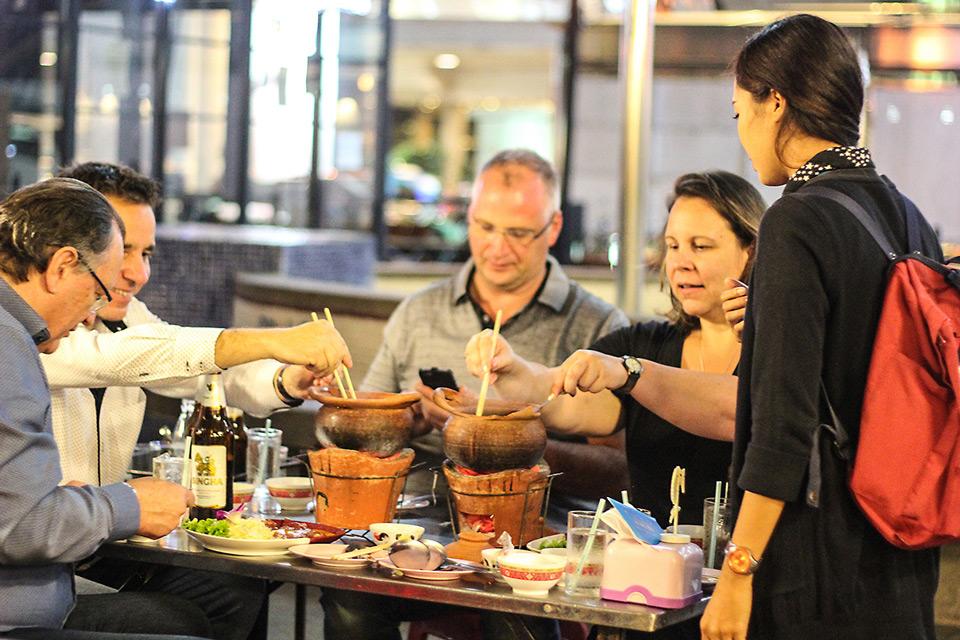 Customers eating hot pot on Motorbike Tour | Bangkok night tours | Bangkok Food Tours